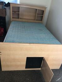 brown wooden bed frame and blue mattress Los Angeles, 91406