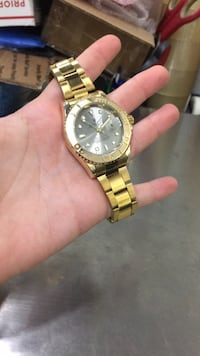 round gold-colored chronograph watch with link bracelet Gaithersburg, 20879