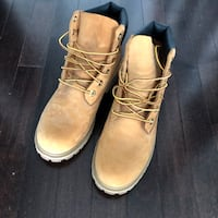 pair of brown leather work boots Toronto, M6H 0E4