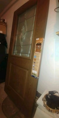 brown wooden framed glass display cabinet Edmonton, T5C 2V9