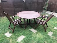round brown wooden table with four chairs Filey, YO14 0NN