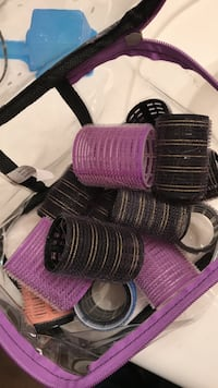 purple and black plastic hair curlers