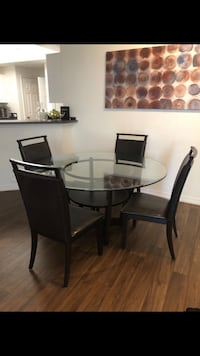 Glass top dark brown dining table  Coral Springs, 33067