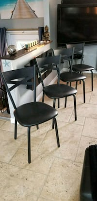 two black leather padded chairs Longueuil, J3Y 2Z6