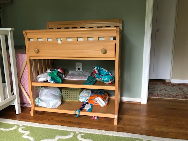 Baby changing table with cushion