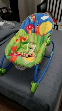baby's green and blue bouncer Los Angeles, 90016