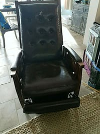 black leather padded rolling armchair Queens, 11364
