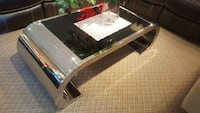 white and black wooden framed glass top coffee table