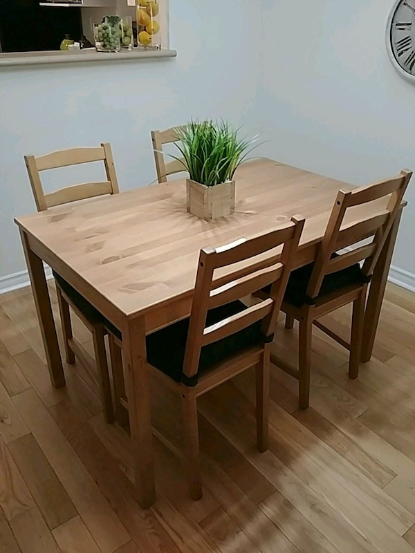 brown wooden table w/ four chairs di