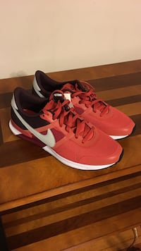 pair of red-and-white Nike running shoes Frederick, 21701