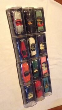 Lot of 12 Collectible Vehicles in Cases.