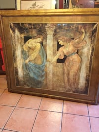 one brown wooden framed painting of woman Laredo, 78040