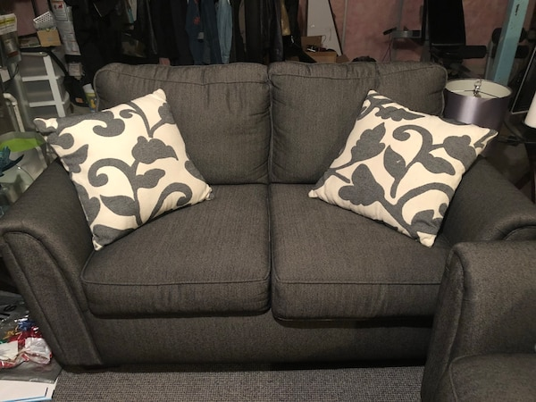 Gray fabric 2-seat sofa with throw pillows