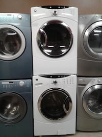 four white front-load clothes washer and dryer set null