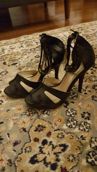 pair of black open-toe ankle strap heels size 7 545 km