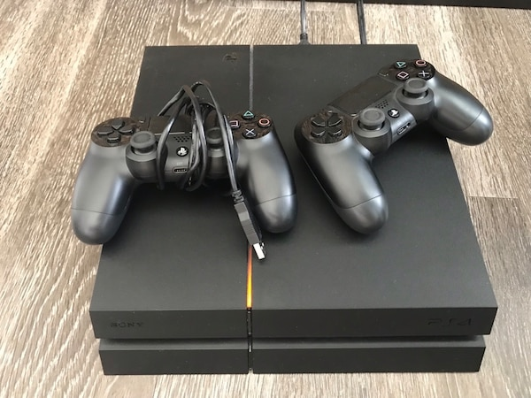 Black sony PS4 console with two controllers b66fbff1-3f38-4ae6-ac97-b7bec27dc65c