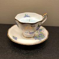 white and blue ceramic teacup with saucer Vaughan