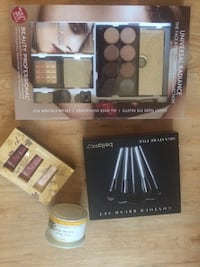 assorted makeup palettes and brushes