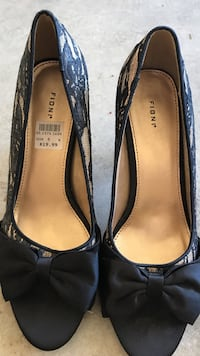 pair of black leather pointed-toe flats