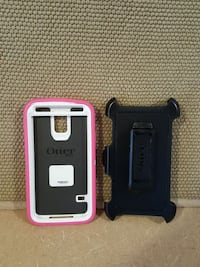 two black and pink Otter Box smartphone cases