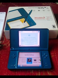 blue Nintendo DS with game cartridges Edmonton, T5L