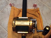 black and gray fishing reel Farmingdale, 07727