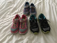 three pairs of black and red athletic shoes