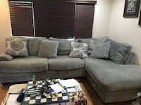 gray suede sectional couch with throw pillows Las Vegas, 89145