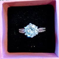 Sterling silver and white 4 carat stone, high quality, size 5 1/2 to 6 Sparks, 89441