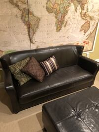 Gorgeous faux leather sofa. Stylish and modern