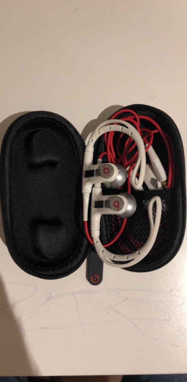 white and red Beats by Dr