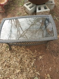 Outside wicker and glass coffee table