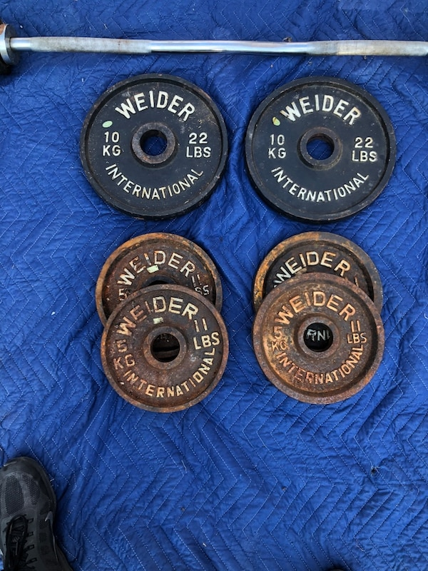 Bar and Weider weights of 88 lbs 4c38eb70-ccde-4636-a5b3-a29fd3d7a6ae
