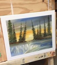 green trees near river painting