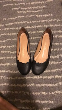 pair of black leather flats Arlington, 22201