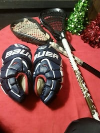 Lacrosse sticks and Bauer gloves.