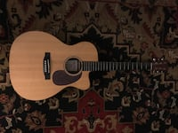Martin custom x series acoustic/electric. case kept, excellent condition