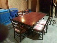 rectangular brown wooden table with six chairs din Columbia, 29223
