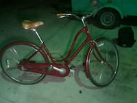 red and black cruiser bike 2244 mi
