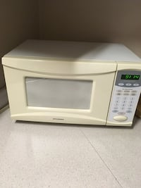 white General Electric microwave oven Cambridge, N1S 4Y9
