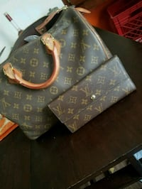 black and brown Louis Vuitton leather handbag Concord, 28025