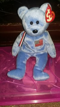 blue and white bear plush toy Green