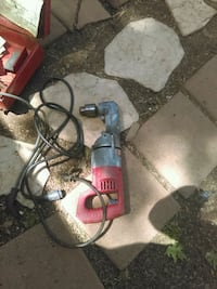 gray and red corded power tool