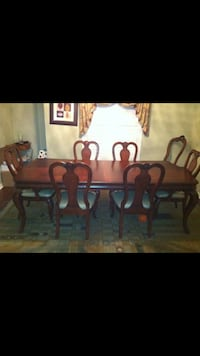 Brown wooden dining table set 556 km