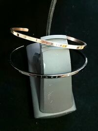 A silver-colored and Rose Gold Inspire bangles