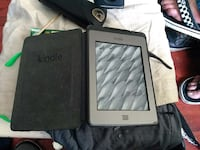 gray Kindle e-book reader in black leather case 3496 km
