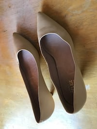 women's pair of beige leather kitten heels