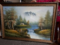brown wooden framed painting of house near body of water 3136 km