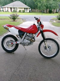 red and black Honda motocross dirt bike Geismar, 70734