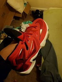pair of red Nike basketball shoes 2378 mi